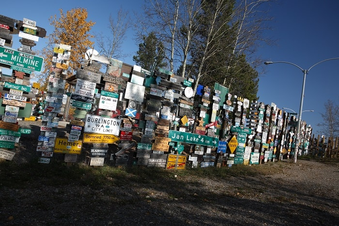 Sign posts forest in Watson Lake Yuko