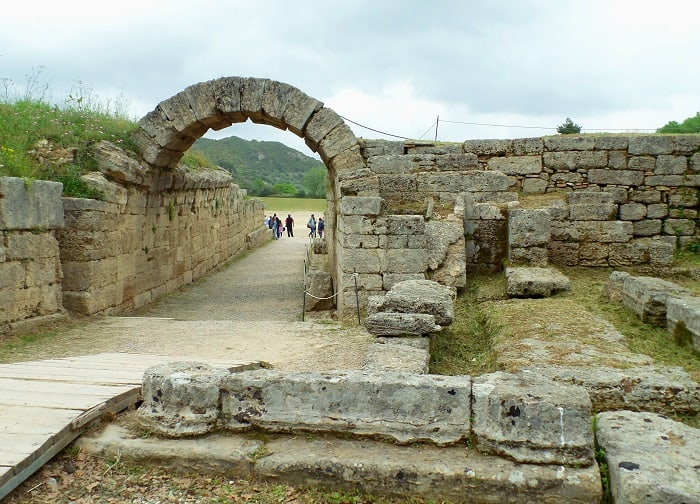The stone archway leading to the historic stadium of the Ancient Olympia, archaeological site in Peloponnese, Greece