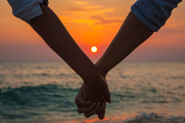Must Do's for a perfect romantic getaway - Holding Hands on the Beach