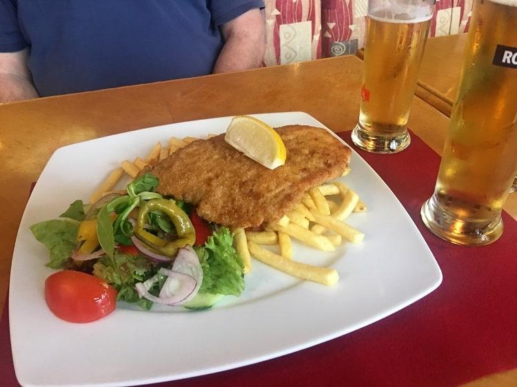 Eating Chicken Schnitzel in Rostock Germany