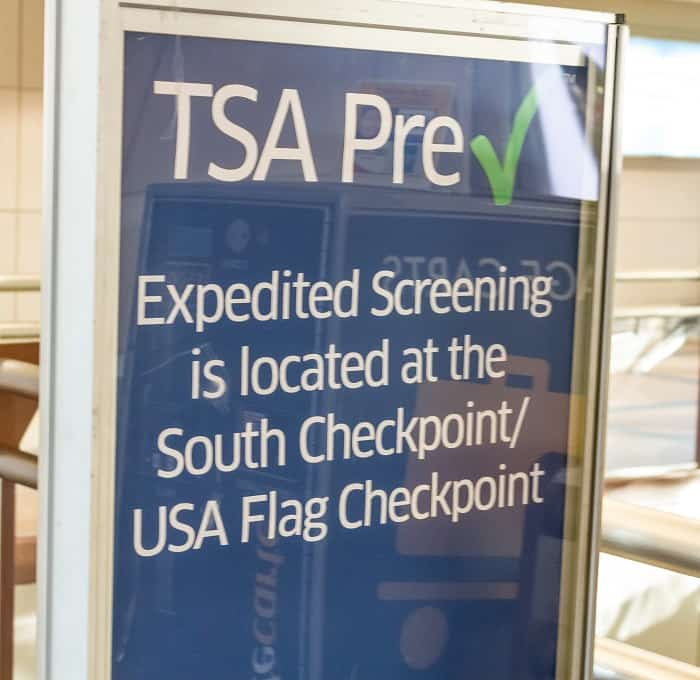 TSA Pre Check in Expedited Screening sign at airport
